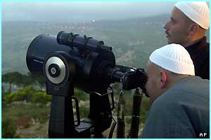 These villagers in Beirut, Lebanon, used an impressive looking telescope to take a closer look..