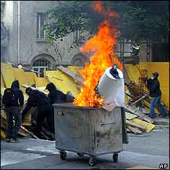 Barricade and burning bin in Lausanne