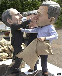 Protesters depicting Bush, Chirac and Schroeder stage a mock fight over cheap subsidised products to Africa