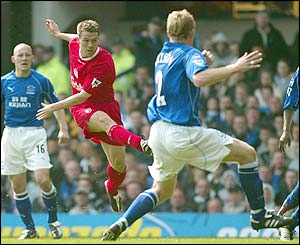 Michael Owen gives Liverpool the lead against Everton at Goodison Park