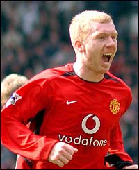 Paul Scholes celebrates his brace for Man Utd against Blackburn