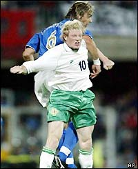 Italy's Nicola Legrottaglie and Northern Ireland's Andrew Smith jump for a header