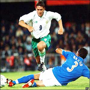 Northern Ireland's David Healy jumps over Italy's Fabio Grosso