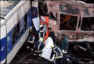 Rescuers take a body out of the wreckage, 4 June 2003