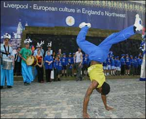 A street performer celebrates Liverpool's new status