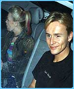 Jon and Hannah leaving the concert in a car