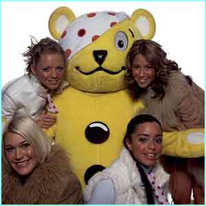 The girls cuddle up to Pudsey bear
