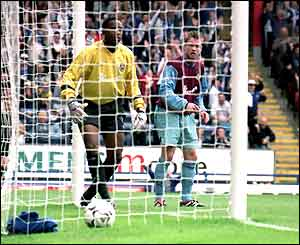 Shaka Hislop picks the ball out of the net after the seventh goal goes in