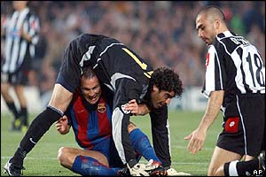 Barcelona's Patrik Andersson tangles with his goalkeeper Roberto Bonano while Juventus' Marco Di Vaio looks on