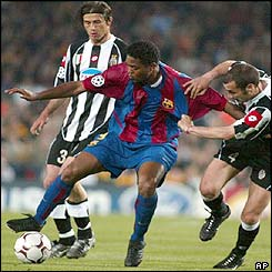 Barcelona's Patrick Kluivert is held back by Juventus' Uruguayan player Paolo Montero