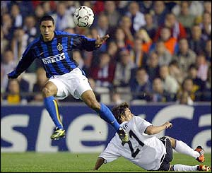 Inter Milan's Ivan Cordoba jumps over Valencia's Pablo Aimar