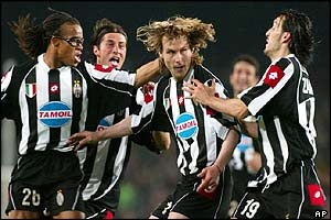 Juventus' Pavel Nedved is congratulated by team mates after scoring against Barcelona