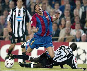 Barcelona's Michael Reiziger is challenged by Juventus' Lillian Thuram