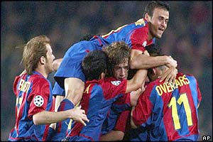 Barcelona's Luis Enrique, top, jumps on top of various team-mates after  Xavi scores against Juventus