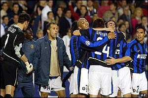 Inter Milan's players celebrate beating Valencia on away goals