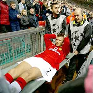 David Beckham is stretchered off against Deportivo La Coruna in March 2002