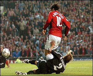 Manchester United's Ruud van Nistelrooy pulls a goal back against Real Madrid to make the score 1-1
