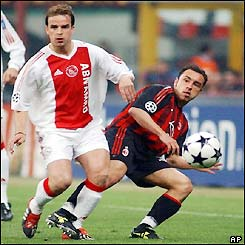 Cristian Brocchi (right) gets a shot past Ajax's Wesley Sneijder