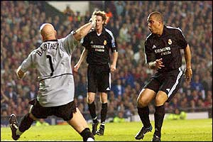 Real Madrid's Ronaldo scores his sides second goal past Manchester United's goalkeeper Fabien Barthez