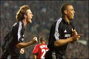 Real Madrid's Ronaldo celebrates scoring the second goal against Manchester United with Steve McManaman