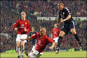 Real Madrid's Ronaldo scores his hat trick goal against Manchester United as Wes Brown slides on to tackle