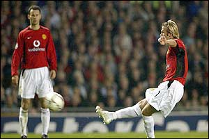 Manchester United's David Beckham scores with a free-kick against Real Madrid