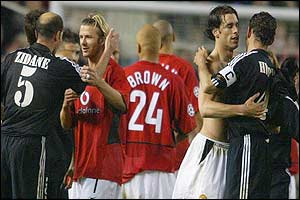 Manchester United's David Beckham and Ruud Van Nistelrooy are consoled by Zinedine Zidane and Fernando Hierro of Real Madrid