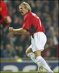 Man Utd's David Beckham celebrates scoring against Real Madrid