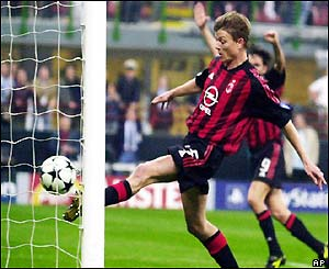 Jon Dahl Tomasson scores for AC Milan