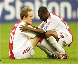 Ajax's Petri Pasanen and Jelle Van Damme are devastated after their defeat