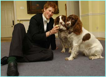 Rosie and Jenny, his House Master's dogs with Prince Harry