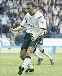 Youri Djorkaeff celebrates scoring Bolton's first goal after 74 minutes