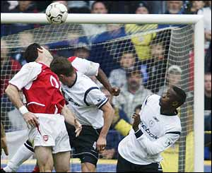 Arsenal centre-back Martin Keown heads into his own net to bring the scores level at 2-2