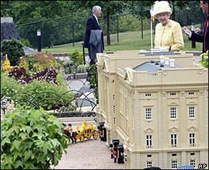 The Queen looking at a miniature model of Buckingham Palace