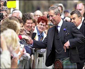 Prince of Wales is greeted by members of public as he walk along the Royal Mile in Edinburgh