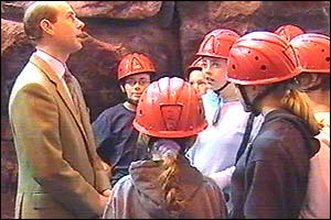 The Earl of Wessex chatting to children in hard hats