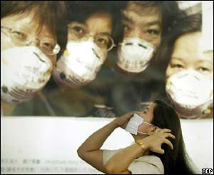 A woman puts on a mask in Hong Kong