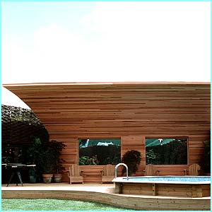 The outside of the house has a pool, a huge grassy bit and a wooden shelter to sit and gossip under