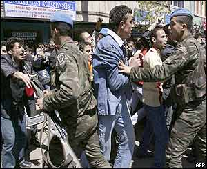 Soldiers try to stop protesters during a demonstration by Bingol residents