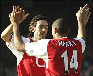 Robert Pires and Thierry Henry celebrate a goal in the 5-1 win over Man City