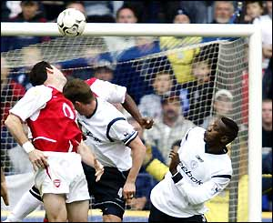 Martin Keown deflects Youri Djorkaeff's free-kick into his own goal for the Bolton equaliser
