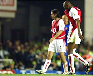 Patrick Vieira trudges off the field injured during the 2-2 draw with Man Utd