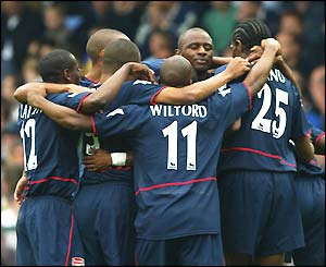 Arsenal players celebrate during their 4-1 victory at Leeds