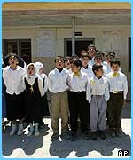 Children in Iraq have to chant together before school