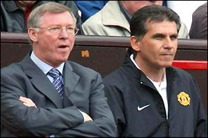 Sir Alex Ferguson and his assistant Carlos Queiroz look on in silence as Charlton equalise