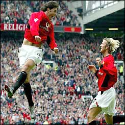 Ruud van Nistelrooy celebrates his second goal with David Beckham