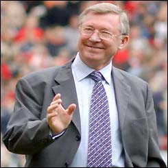 Sir Alex Ferguson smiles and waves to the crowd