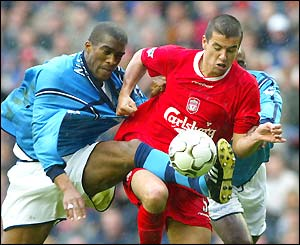 Milan Baros leads the push for an early goal