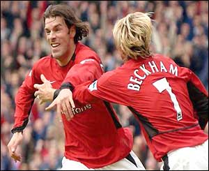 Ruud van Nistelrooy celebrates with David Beckham against Charlton