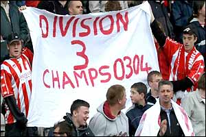 Cheltenham fans wave a banner after relegation
